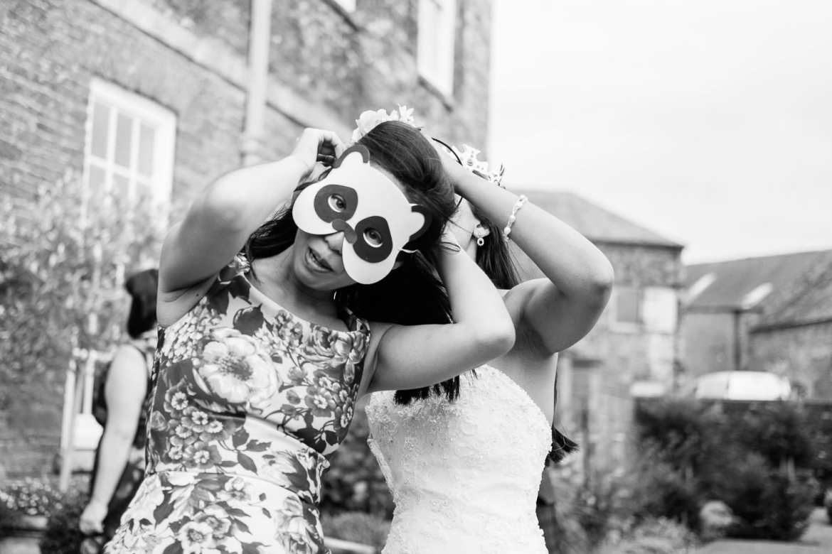 A bridesmaid wearing a pands mask