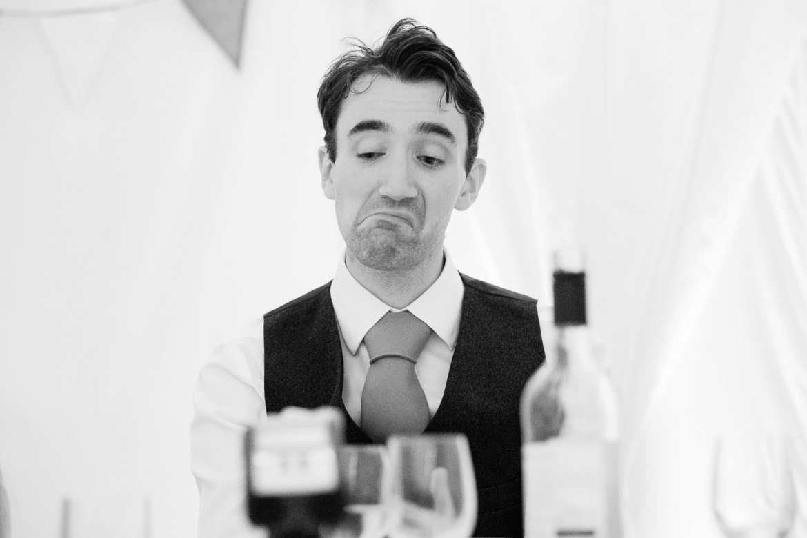 The groom pulls a face