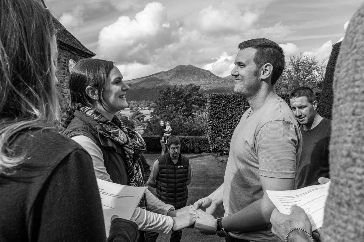 The wedding rehearsal at Plans Brondanw with the mountains in the background