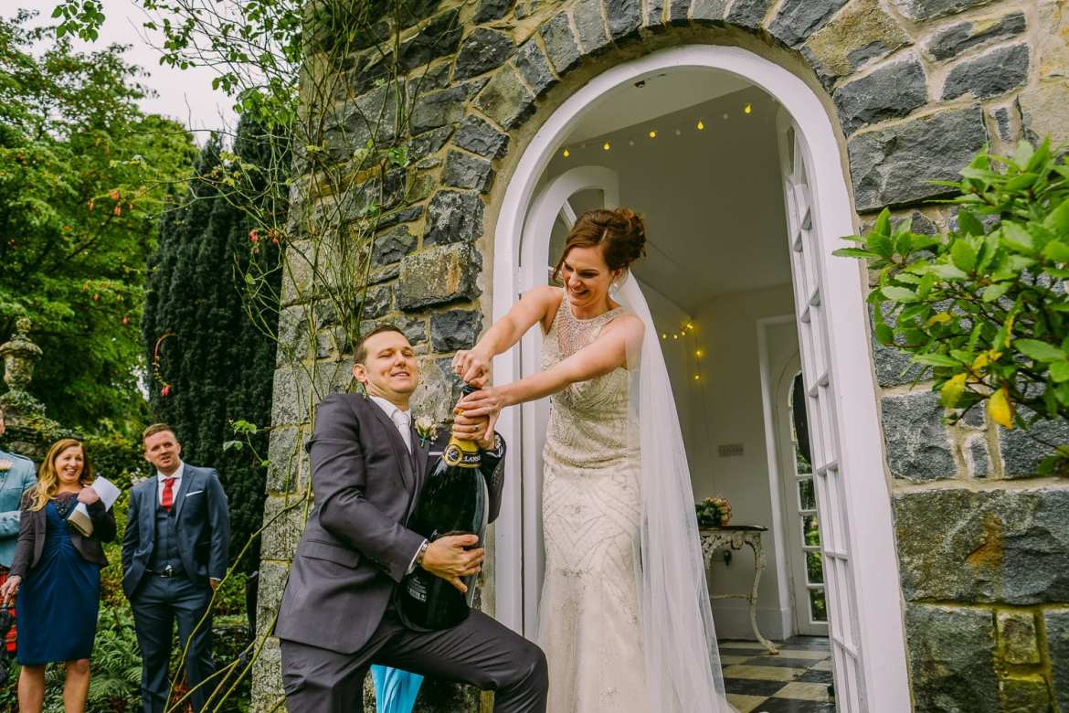 The bride finally pops open the champagne