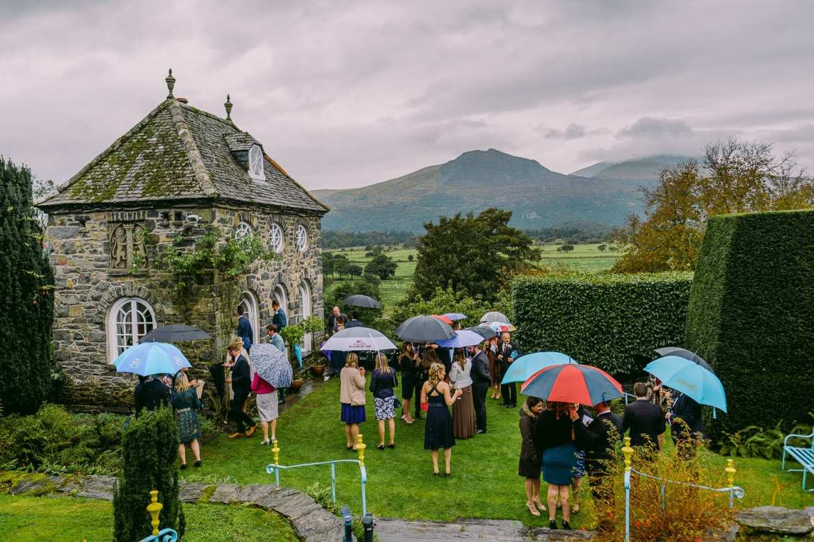 Guests under umbrellas at Plas Brondanw