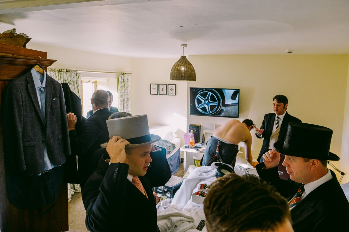The groom and groomsmen getting ready in the Fat Pidgeon