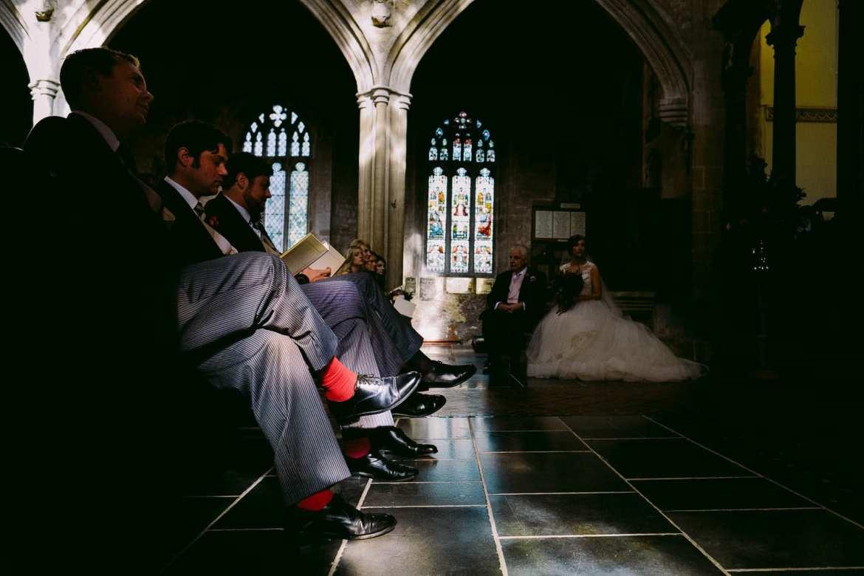 The groomsmen's socks are highlighted in the sunlight