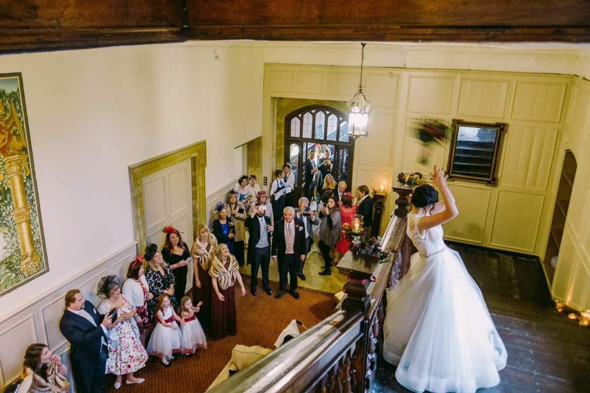 The bride throws the bouquet from the stairs