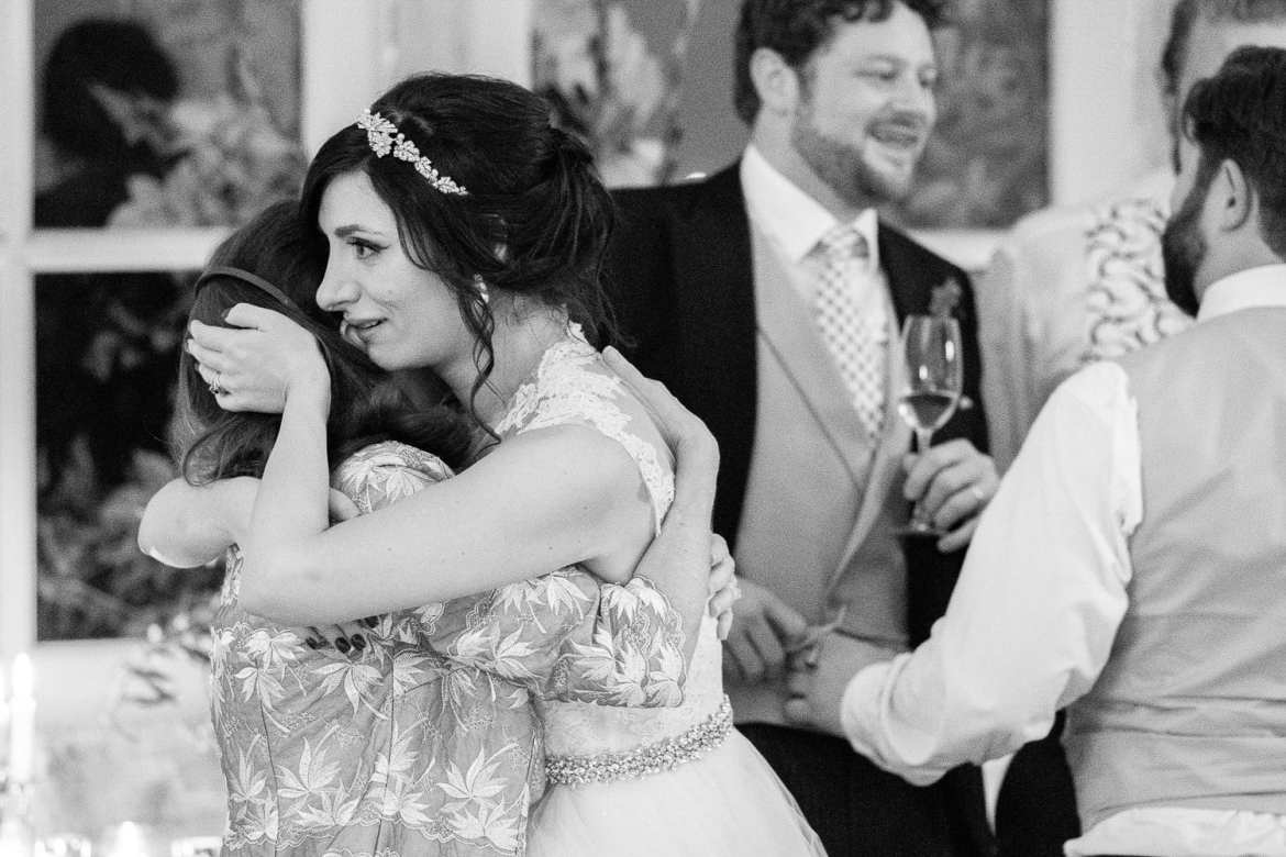 The bride hugs her mum
