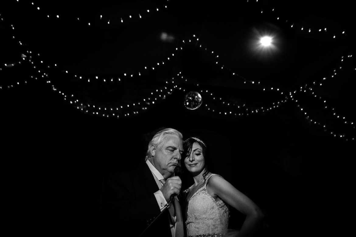 The father of the bride sings to his daughter