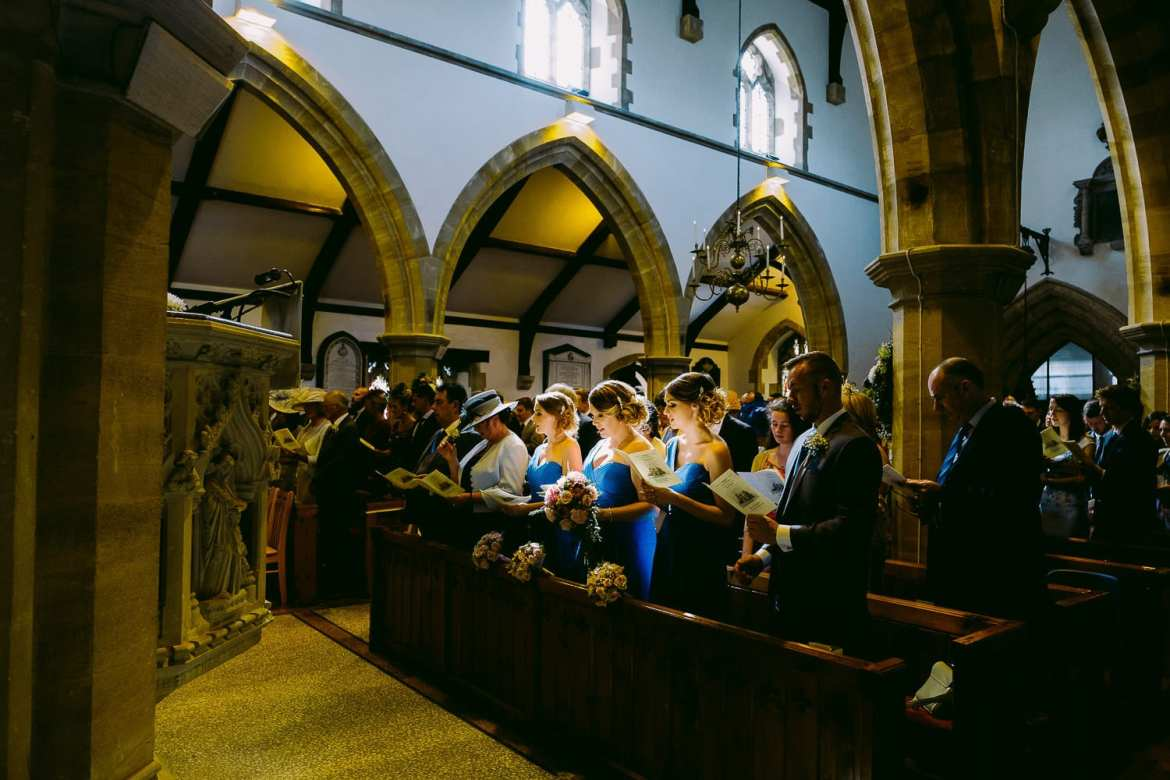 The bridesmaids in church in a pool of light