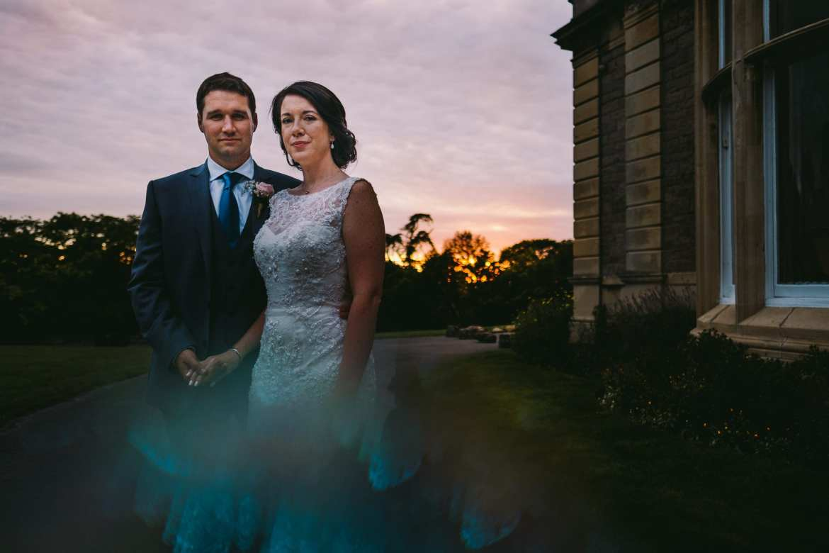 The bride and groom outside Clevedon Hall