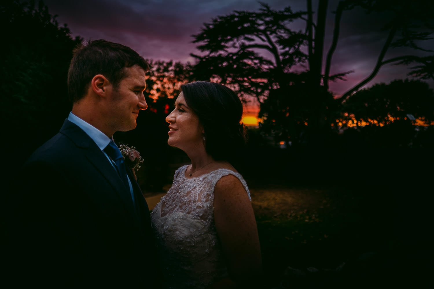 Bride and groom at Clevedon Hall at sunset