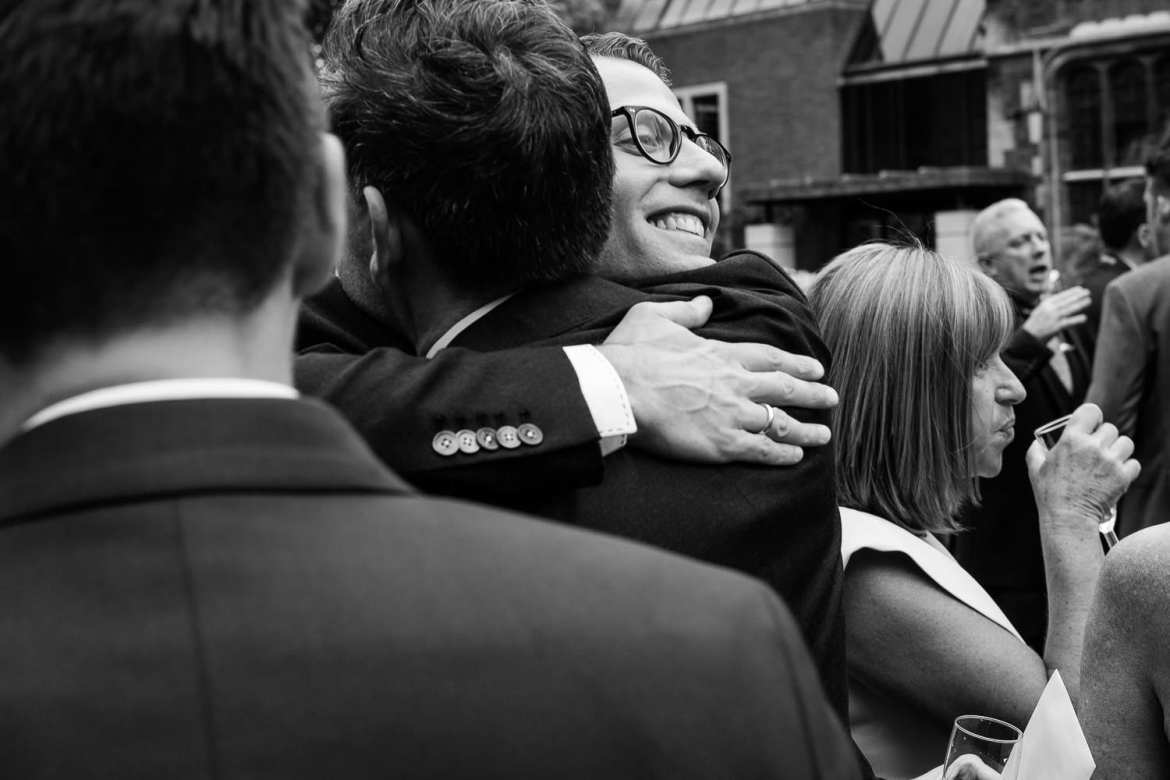 Robert hugging a wedding guest