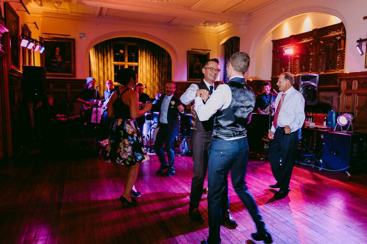Two grooms dancing