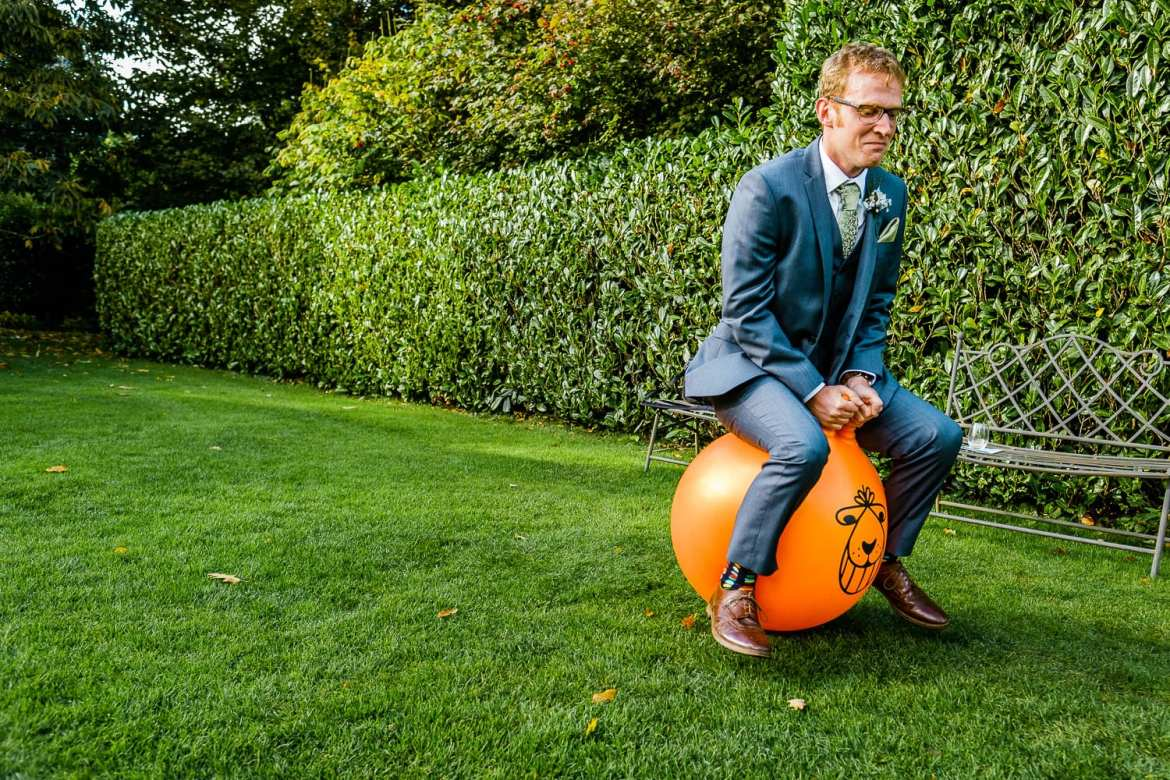 Wedding guest on spacehopper