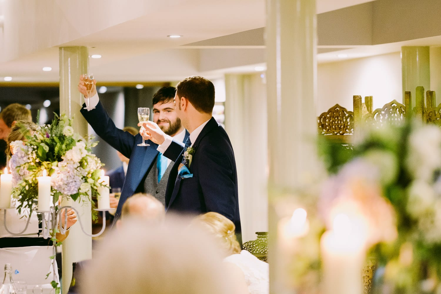 Guests raising a toast to the bride and groom