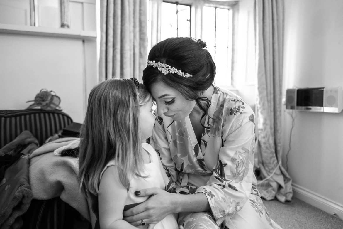 The bride shares an intimate moment with one of the flower girls