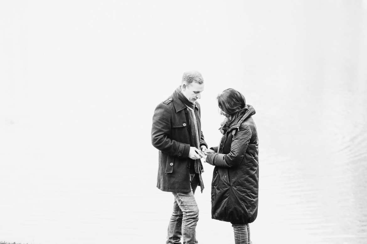 Nathan and Sachini looking down at her engagement ring