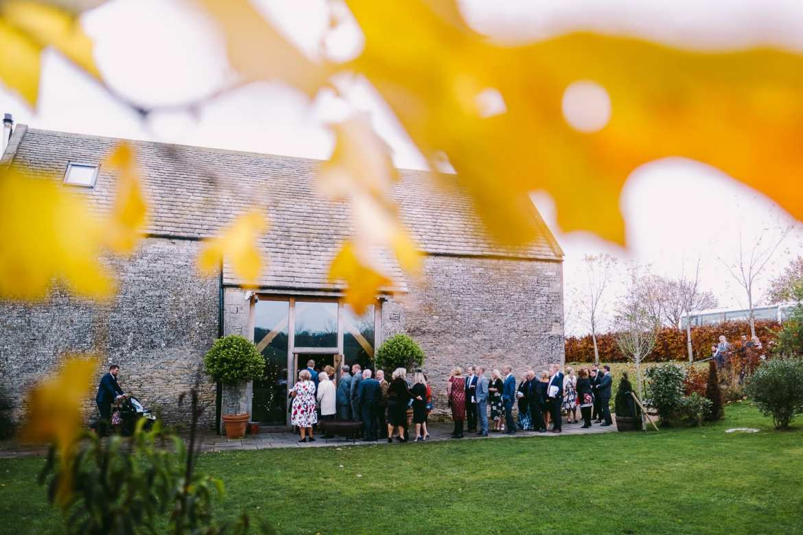Guests queue to enter the ceremony