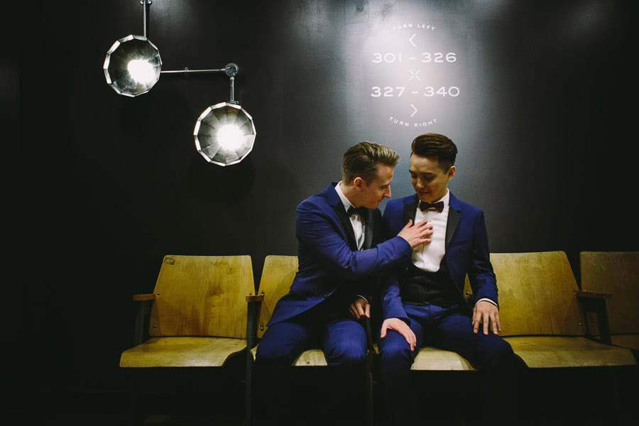 Two grooms waiting for the lift at The Hoxton High Holborn