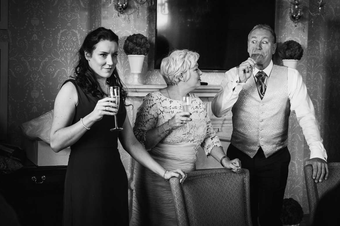 Brides mother father and sister enjoying a drink
