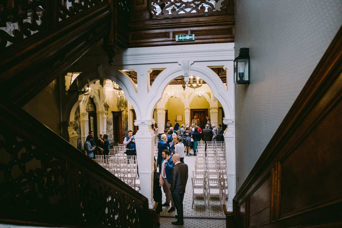View down the stairs of guests getting seated
