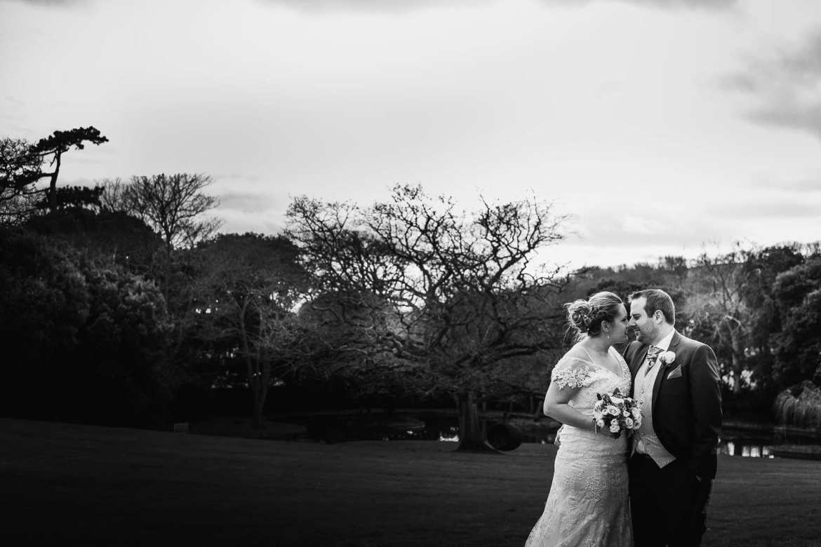 Black and white portrait of bride and groom in the gardens