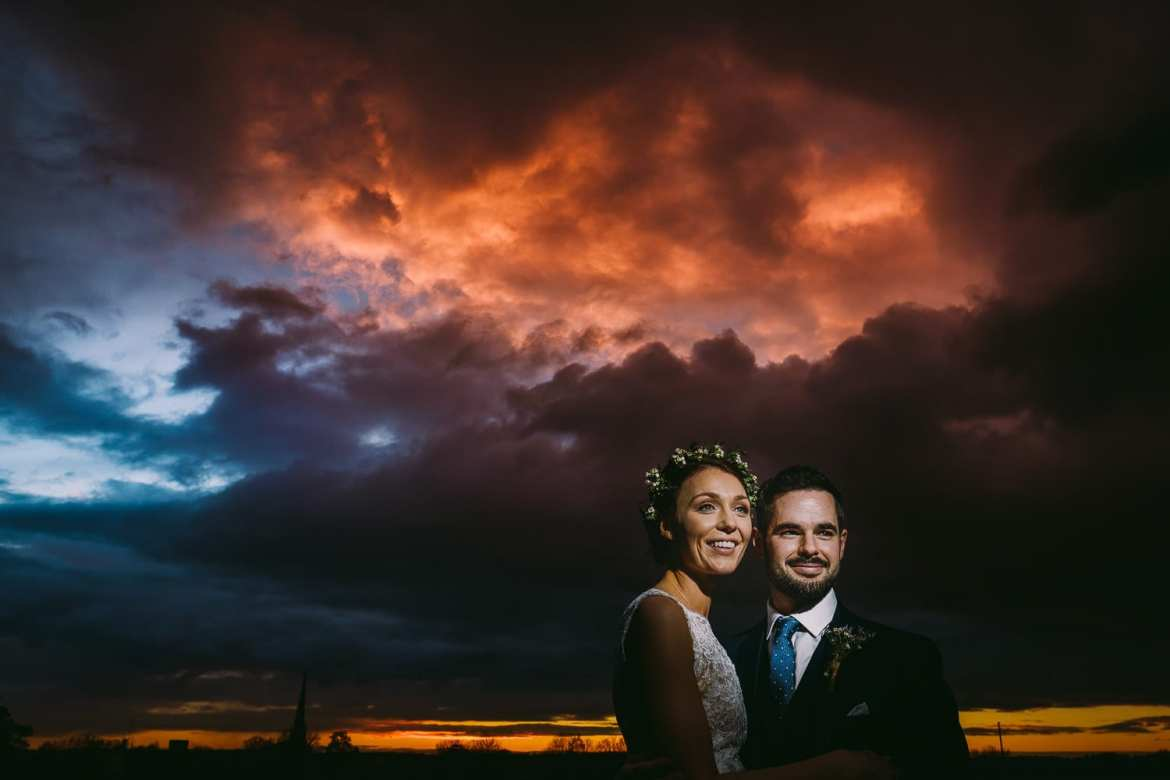 The married couple at sunset during their cotswolds wedding in Tetbury
