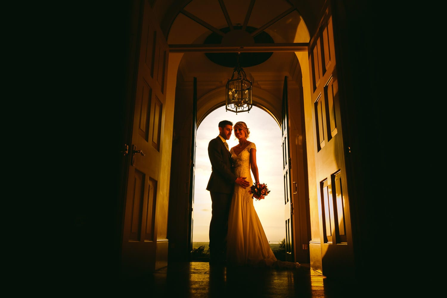 The newly married couple in the doorway
