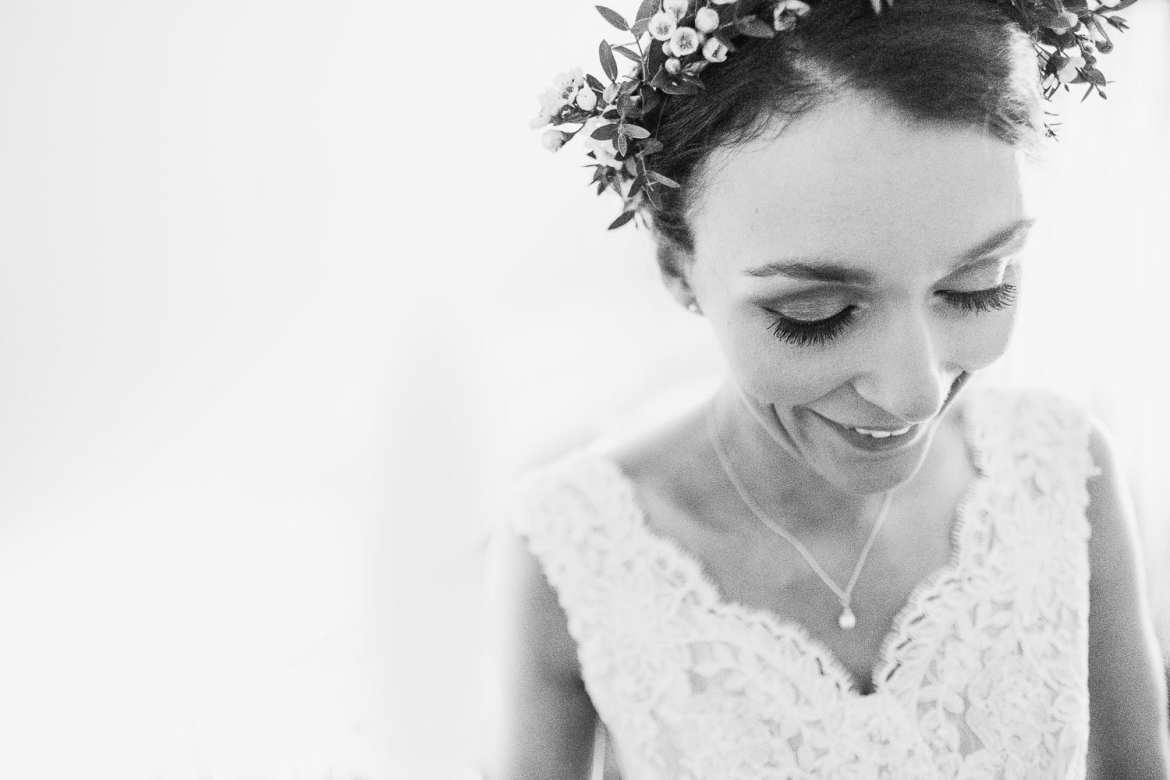 Close up of bride getting into her dress