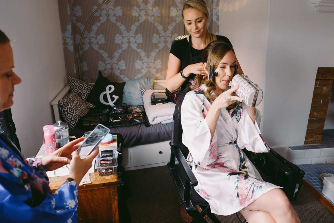 Bridal prep. The bride trying to open a make up bag
