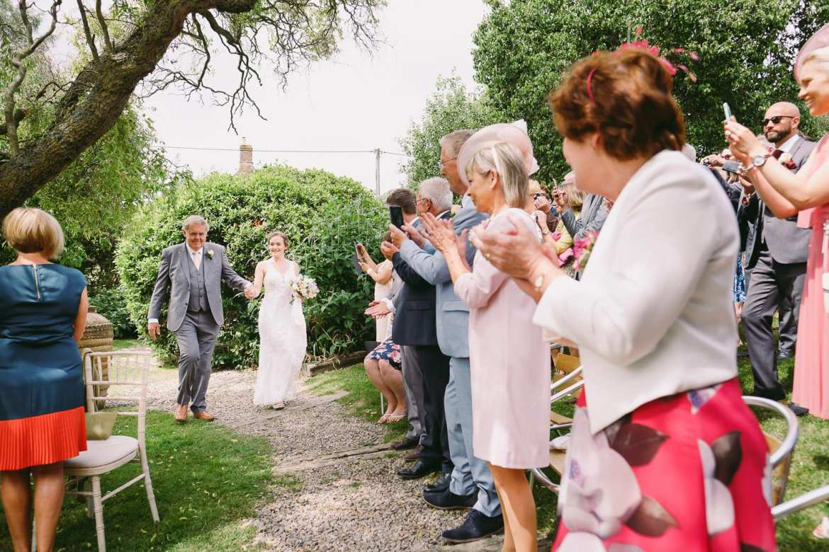Guests cheer the arrival of the bride