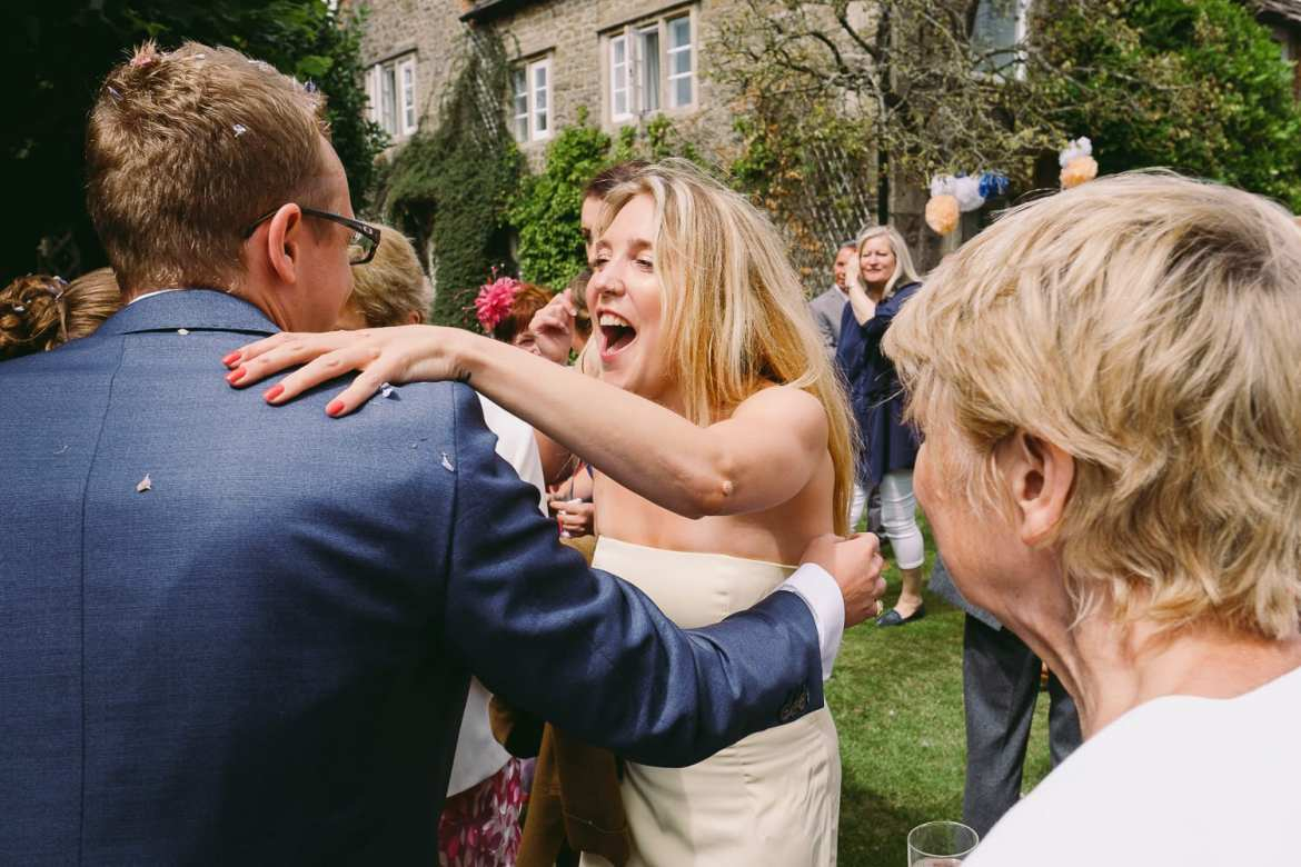 Guests laugh and congratulate the newlyweds