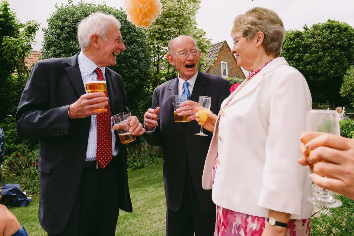 Wedding guests laughing and talking