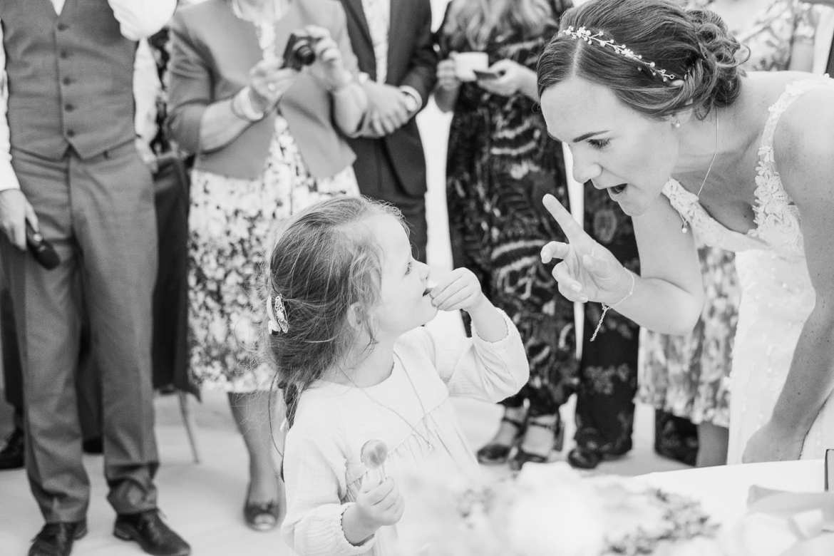 The bride talks to a flower girl