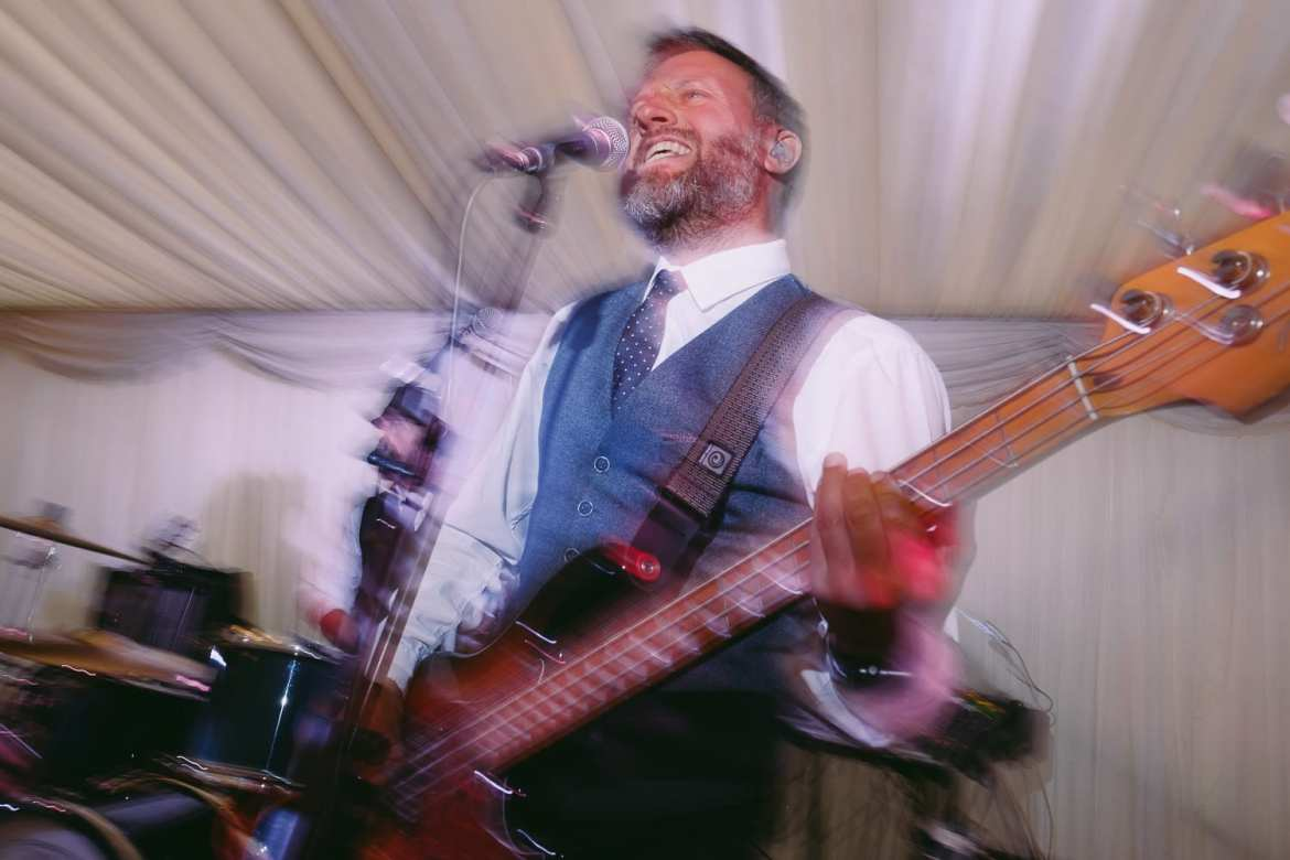 The bass player of the wedding band