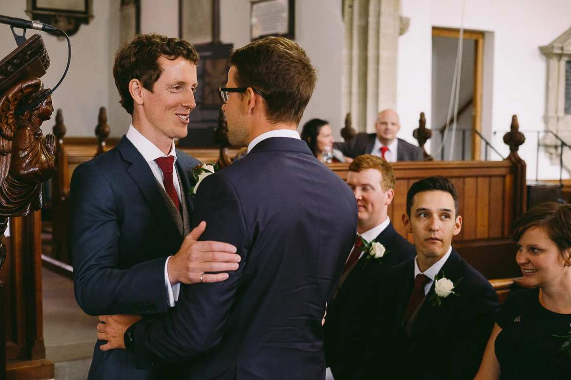 The groom and usher in the church