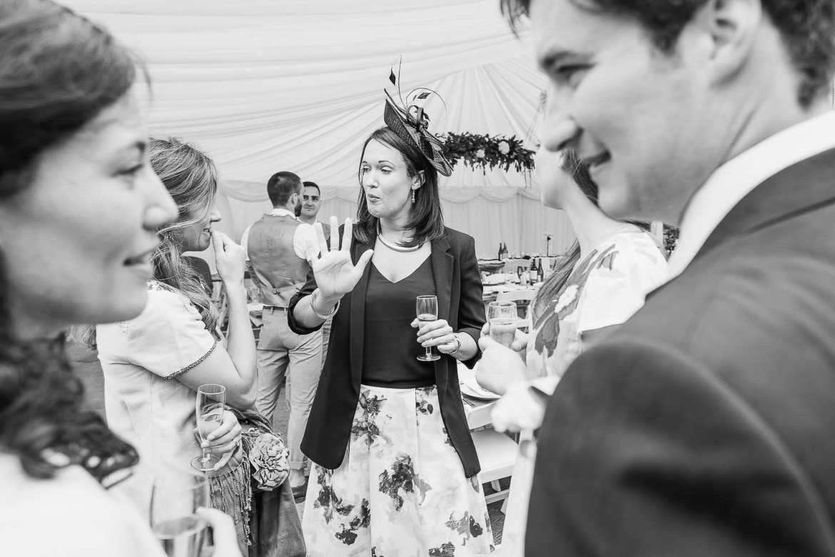 Wedding guests talking and laughing