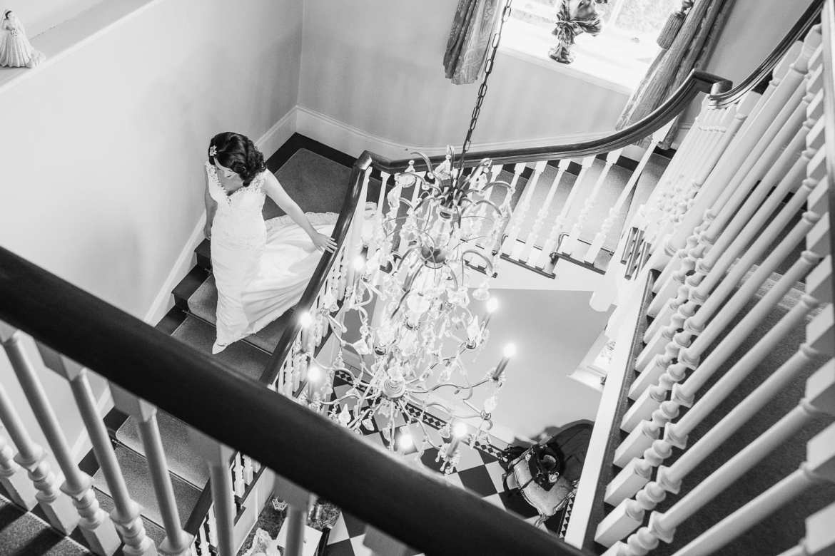 The bride descends the stairs in the bride's manor
