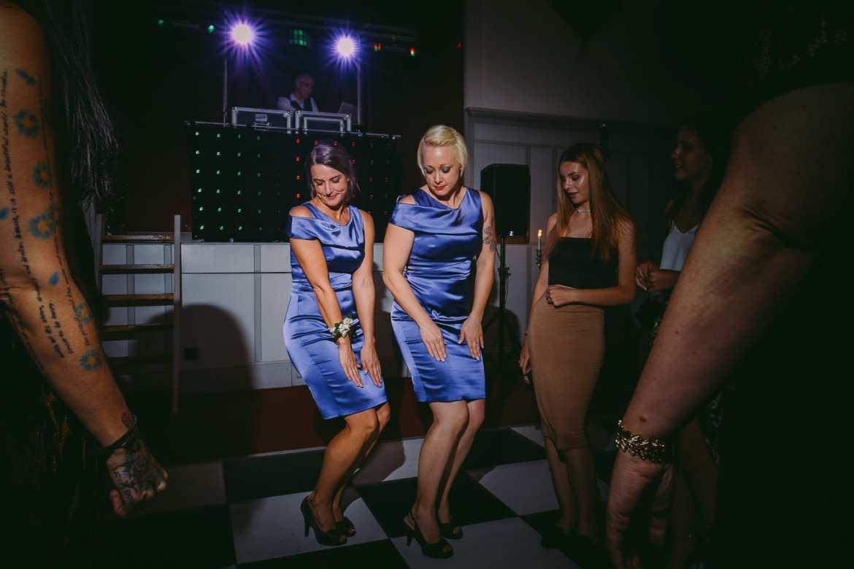 Two bridesmaids dancing