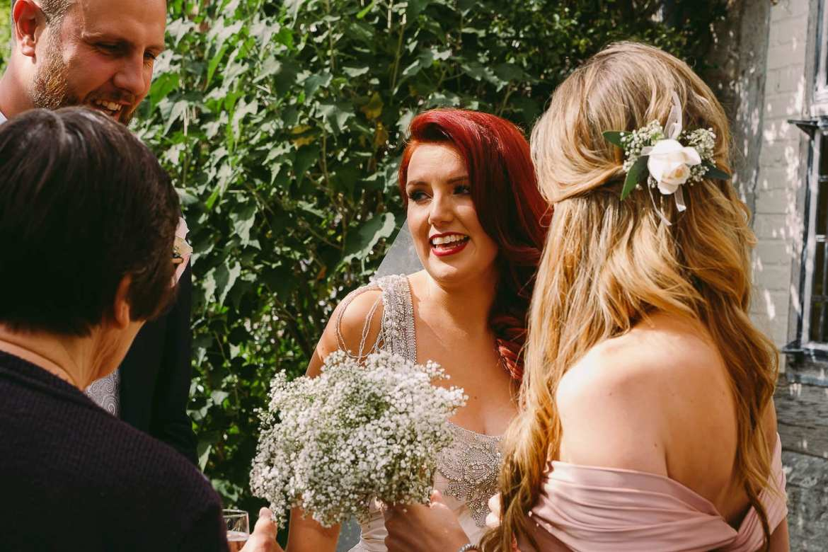The bride greetes her guests
