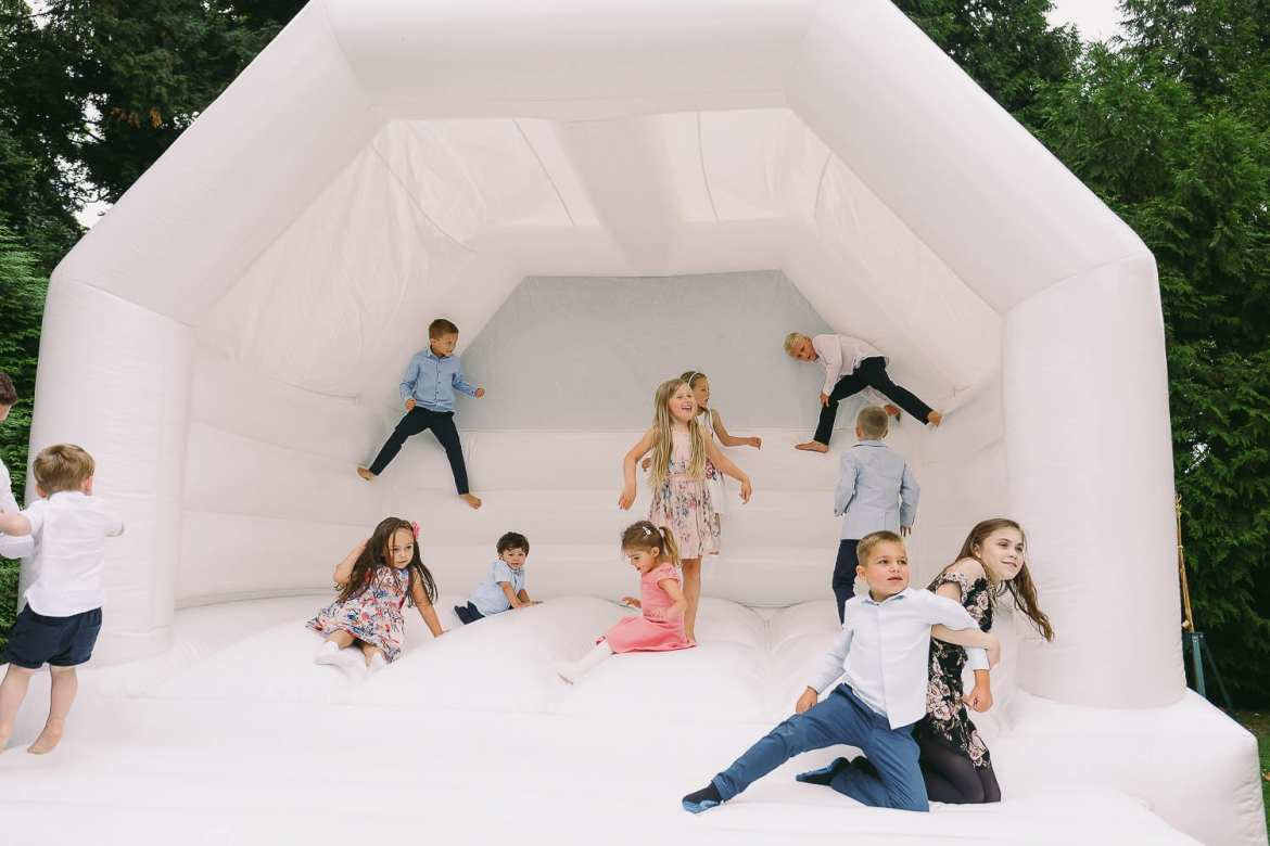 Children on a white bouncy castle