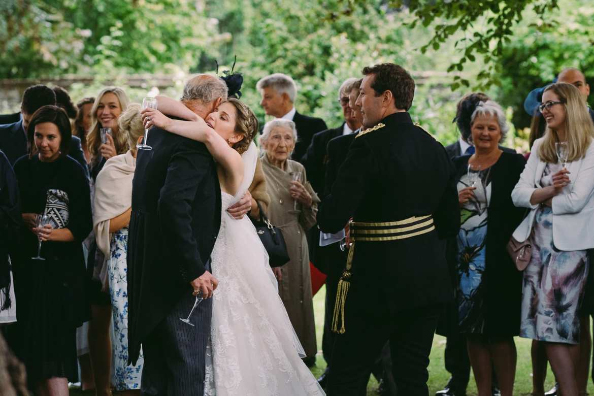 The bride hugs her dad after his speech