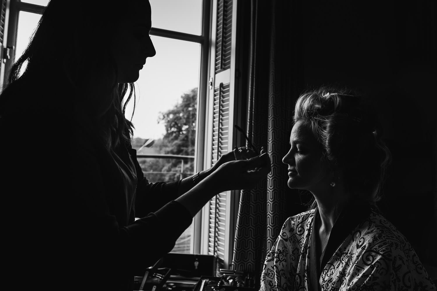 Bride getting ready at Cowley Manor