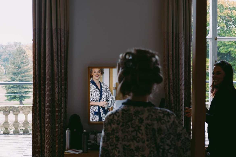 Bridesmaid looking in the mirror