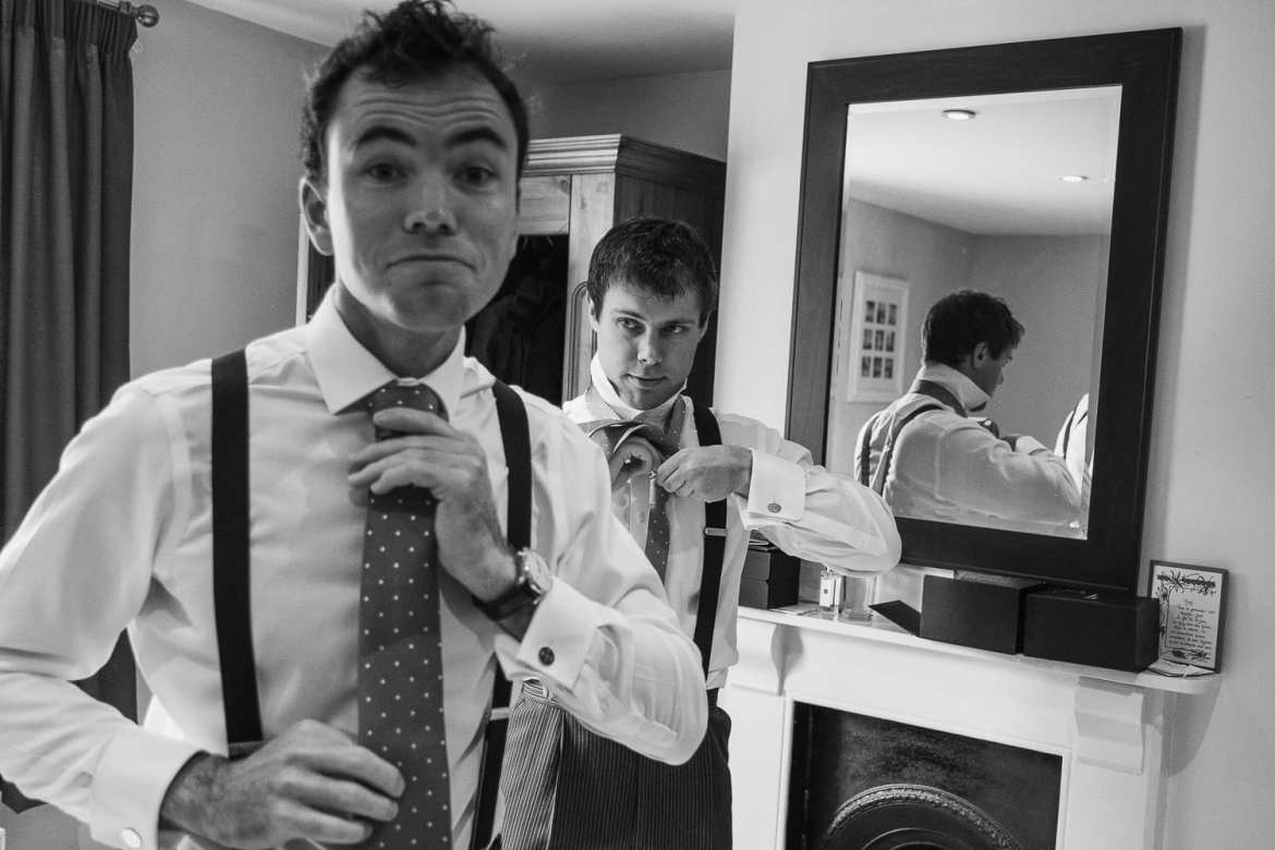 Fixing the ties during groom prep
