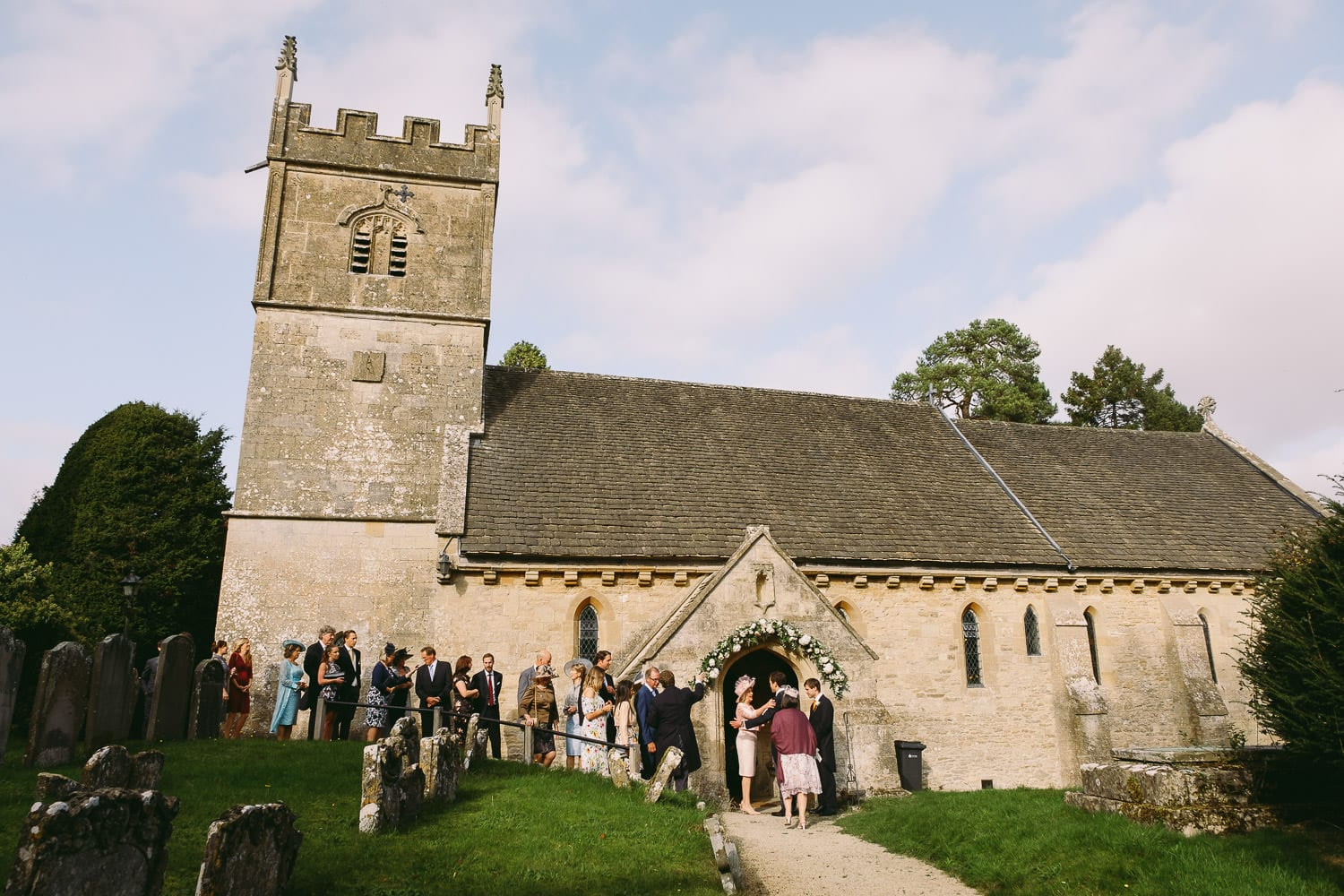 wedding guests outside the church