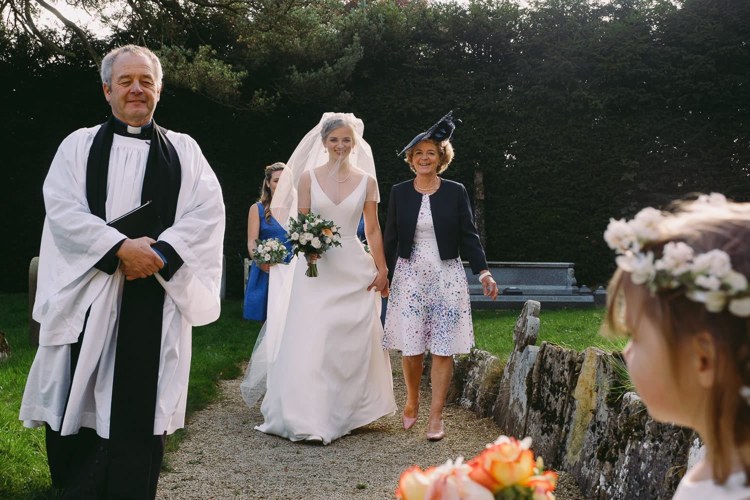 The bride arrives at the church
