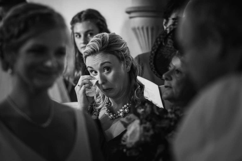 Emotional Bridesmaid in church at Cowley Manor