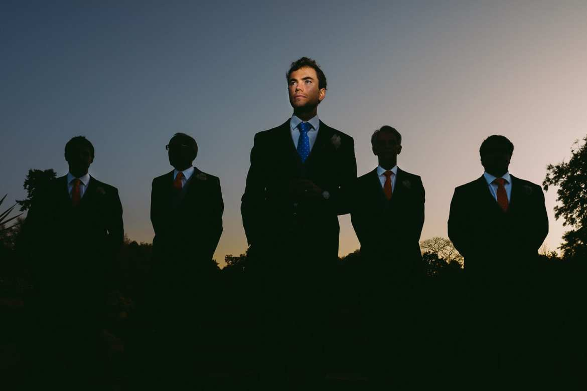 Silhouette of the groomsmen with the Groom at Cowley Manor