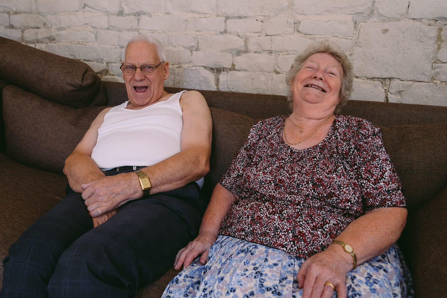 The bride's grandparents laughing