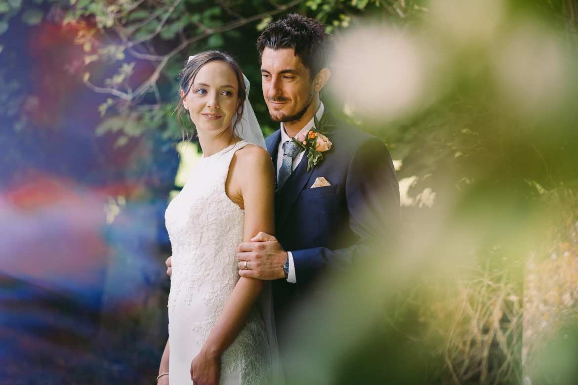 A portrait of the bride and groom in the churchyard
