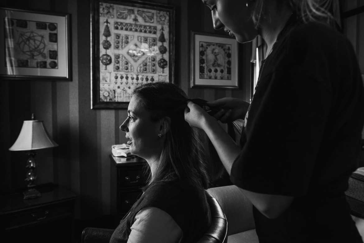 A bridesmaid having her hair done